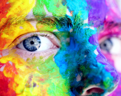 Rainbow paitined face of a young person