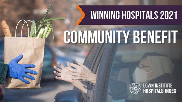 Volunteer handing food bag to elderly person in car